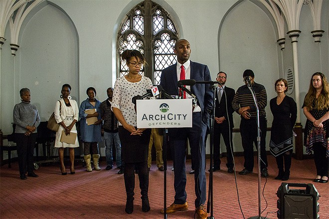 Nicole Nelson and Blake Strode of ArchCity Defenders speak at a press conference announcing a new class-action lawsuit against the city of St. Louis. - PHOTO BY DANNY WICENTOWSKI
