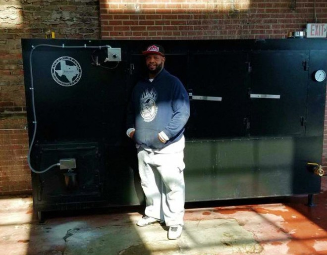 Joe Dixon and his all-wood smoker, Rasputia. - COURTESY OF DIXON'S SMOKE CO