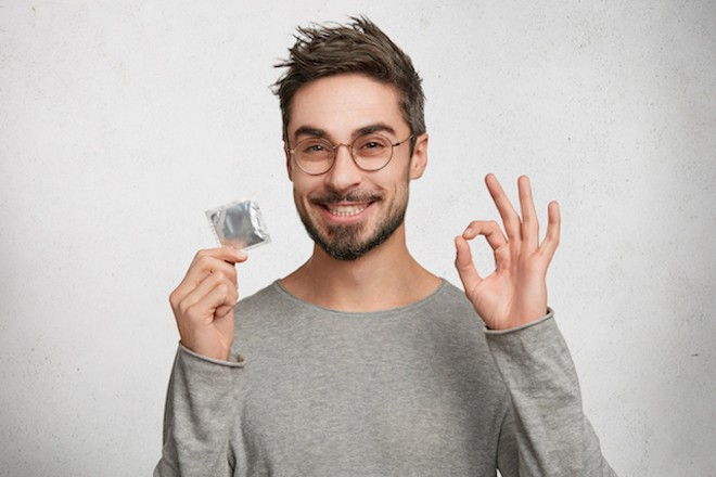 If someone hands you a condom tonight, take it. - SHUTTERSTOCK/WAYHOME STUDIO