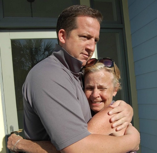 Jim Campbell, left, shares a hug with his estranged mother-in-law, Linda Henley, during happier times. - COURTESY OF ALBERT WATKINS