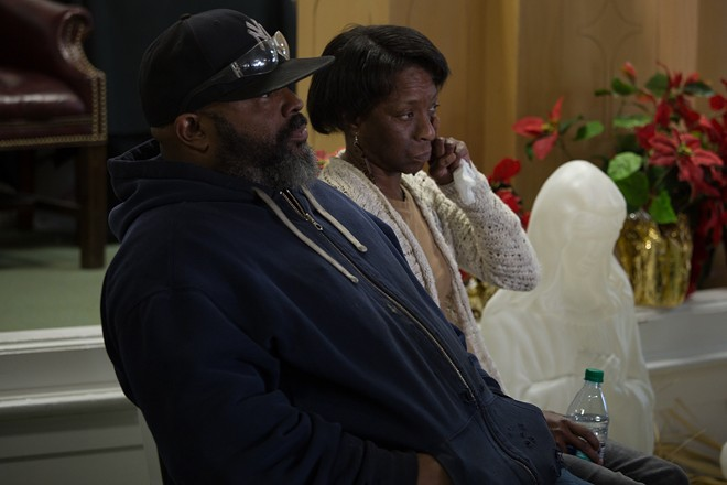 Balls' parents wipe away tears during a press conference. - DANIEL SHULAR