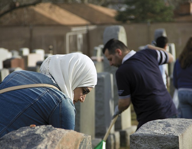 Muslims and Jews worked side by side to clean up a cemetery after a senseless act of vandalism. - DANNY WICENTOWSKI