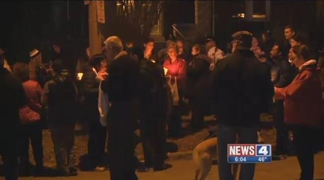 Neighbors held a vigil on Juniata after a grandfather's slaying. - SCREENGRAB VIA KMOV