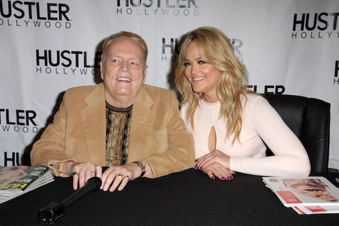 Larry Flynt with a friend in 2016. The porn publisher had a hearing in a St. Louis court today. - SHUTTERSTOCK/KATHY HUTCHINS