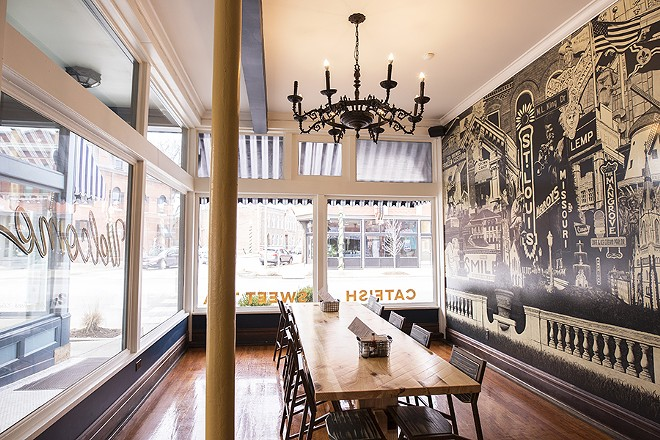 Seating options include a large communal table overlooking Manchester Avenue. - MABEL SUEN