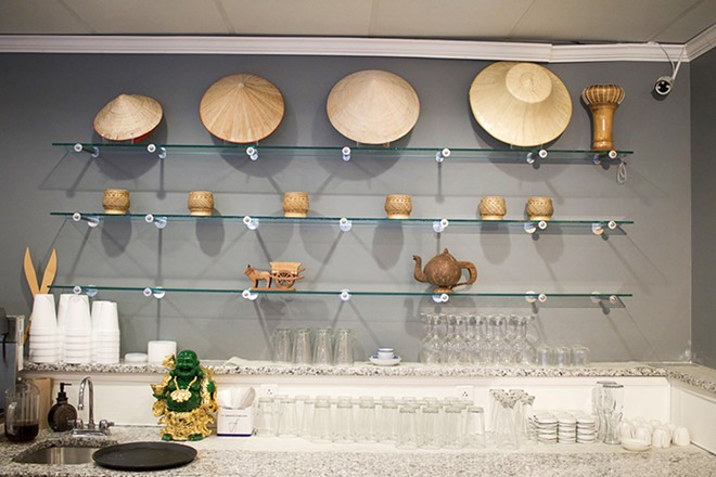 Traditional serving implements decorate the bar area. - CHERYL BAEHR