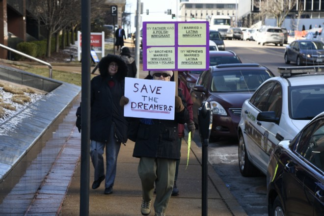 Protesters call on Sen. Roy Blunt to support the Dream Act. - DOYLE MURPHY