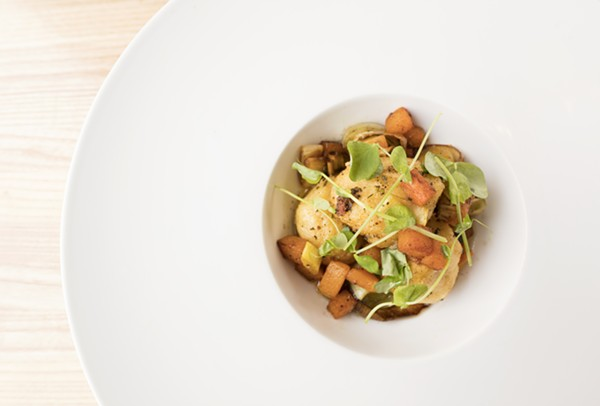 Ricotta gnudi are tossed with roasted squash, leeks and brown butter. - MABEL SUEN