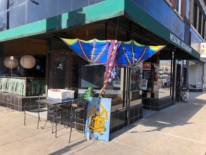 An impromptu memorial to Tu Tien Tran was set up outside his family's restaurant on South Grand today. - COURTESY OF NATASHA BAHRAMI
