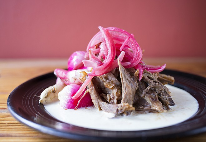 The braised lamb shoulder is a triumph. - MABEL SUEN