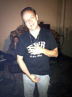 Jesus Lizard's David Yow sporting a Waiting Room shirt on the bar's back patio in July 2012. - PHOTO BY JAIME LEES