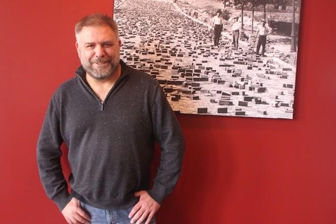 CEO Russ John has cider in his blood. - SARAH FENSKE