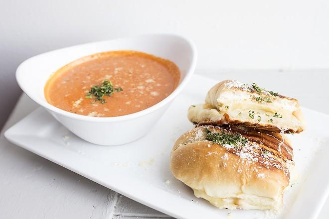 The quattro formaggi sandwich is stuffed with smoked scarmoza mozzarella, fontinella, parmigiana and mozzarella. - MABEL SUEN