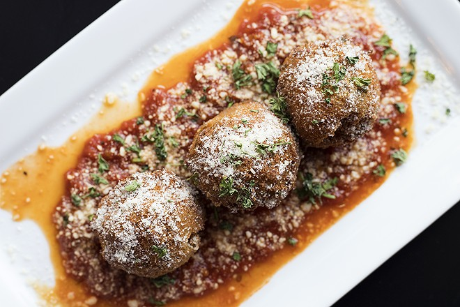 Arancini are a terrific version of the Sicilian classic. - MABEL SUEN