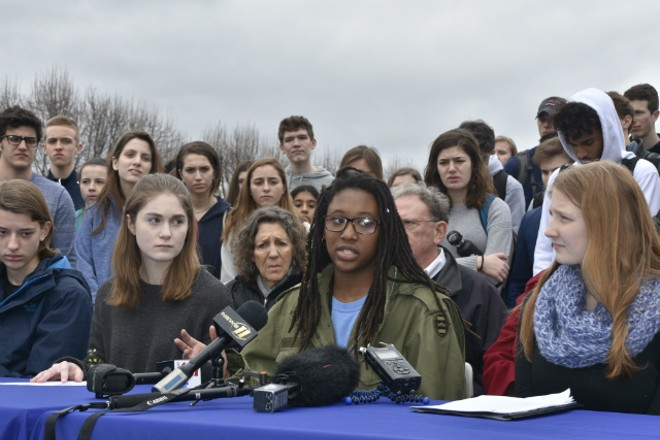 Clayton High School student Hayley Bridges, center, says she fears she could be shot at any moment. - DOYLE MURPHY