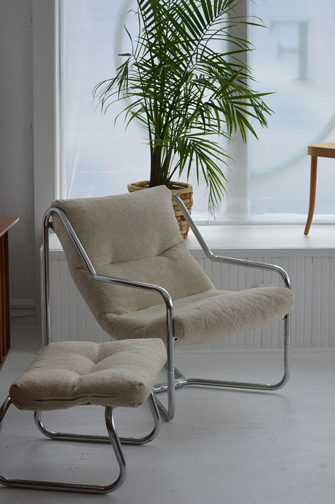 This mid-century chair and ottoman exemplify the store's modern look. - MEGAN ANTHONY