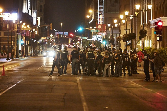 Police mass downtown on Sunday, September 17. - PHOTO BY THEO WELLING