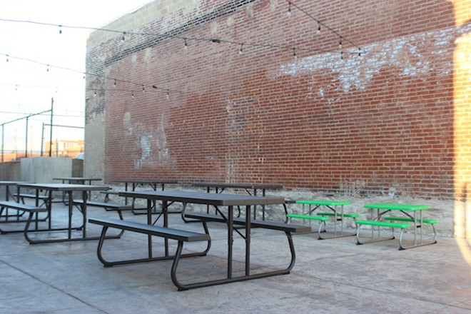 The patio is big and, with brick walls on two sides, has a private, cozy feel. - SARAH FENSKE