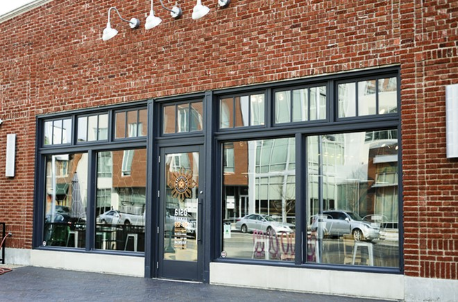The restaurant, which shares a parking lot with Tavolo V, has large windows facing Delmar. - KELLY GLUECK