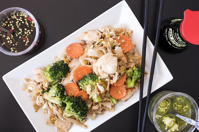 Pad see ew features wide rice noodles and vegetables stir-fried in a sweet, dark soy sauce. - MABEL SUEN