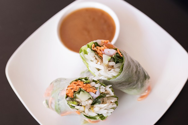 Spring rolls are packed with noodles, beansprouts, basil, cucumbers and carrots. - MABEL SUEN