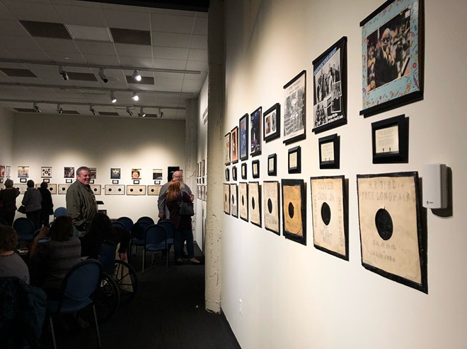 """A visiting group gets the first peek at """"See That My Grave Is Kept Clean,"""" on display at the National Blues Museum through May 19. - PHOTOS COURTESY OF THE NATIONAL BLUES MUSEUM"""