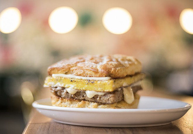 """The """"Biscuit Sand"""" is topped with white American cheese, egg and breakfast sausage. - MABEL SUEN"""