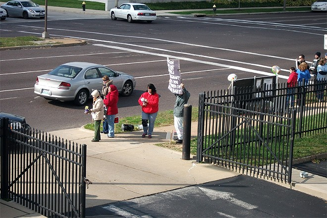 The driveway leading into Planned Parenthood's clinic is frequently crowded by protesters. - COURTESY OF PLANNED PARENTHOOD