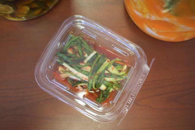 Wol Kim prepares a variety of kimchi. - CHERYL BAEHR
