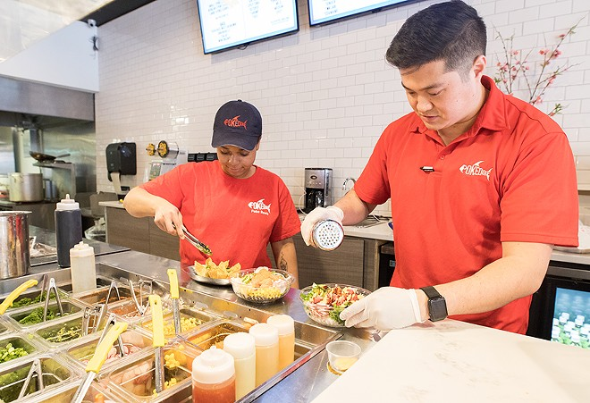 Shih and employee Erin Mann assemble the bowls Chipotle-style in an assembly line. - MABEL SUEN