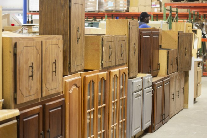Cabinets line one aisle. - HAYLEY ABSHEAR