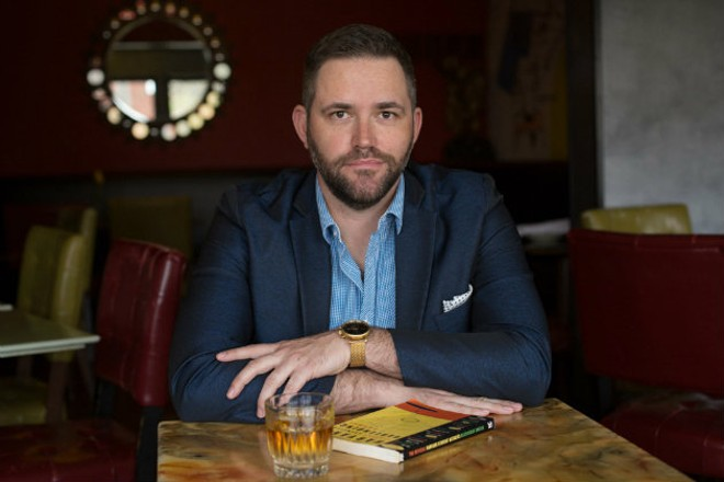 Joshua Johnson spreads the gospel of cocktails with Cocktail Collective. - MONICA MILEUR