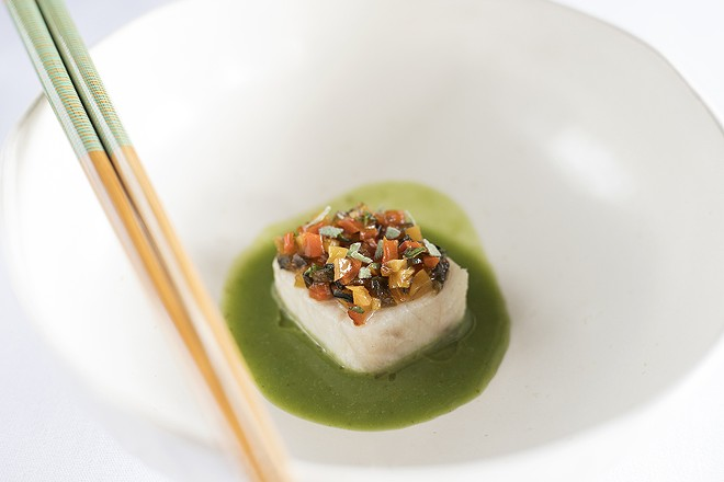 Cobia is served two ways, including with fermented green curry and nuoc cham. - MABEL SUEN