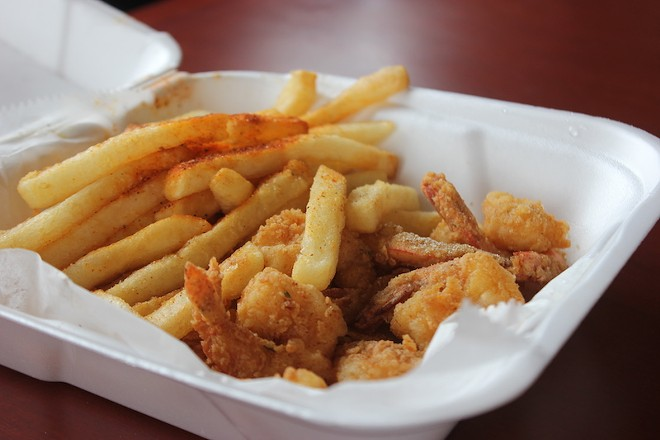 A lunch special features ten pieces of shrimp plus seasoned fries, served with a can of soda for $5.99. - SARAH FENSKE