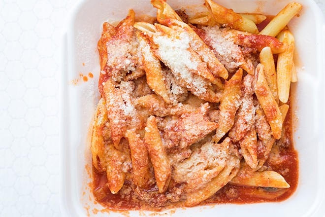 Mostaccioli includes housemade meat sauce and Parmesan cheese. - MABEL SUEN