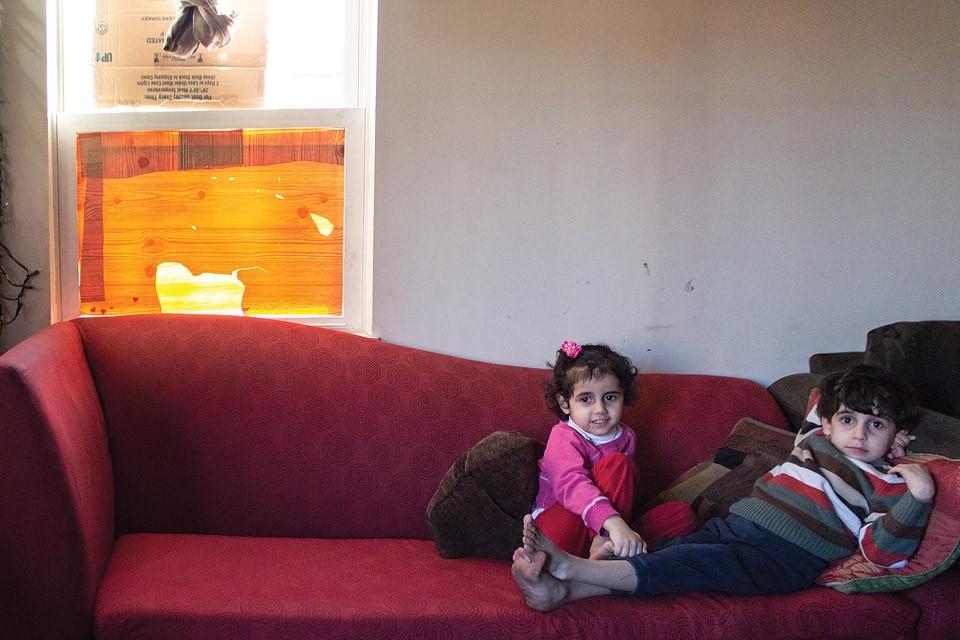 Najlaa Alsaadi's children were - sitting on the couch when someone threw a rock through the window behind them. - SARA BANNOURA