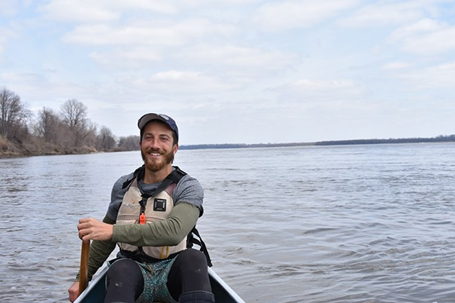 Paul Gruber paddles the Mississippi. - DOYLE MURPHY