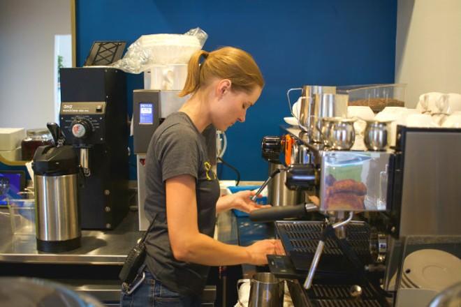 Laura Tetley prepares an espresso drink in Maypop's cafe. - CHERYL BAEHR