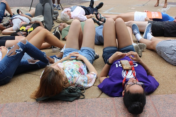 Twenty-three people participated in a die-in outside of U.S. Senator Roy Blunt's office in Clayton on Tuesday. - CAMILE RESPESS