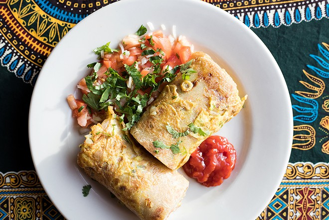 """The """"Rolex"""" is a flat bread filled with an omelet containing tomatoes, onions and green peppers. - MABEL SUEN"""