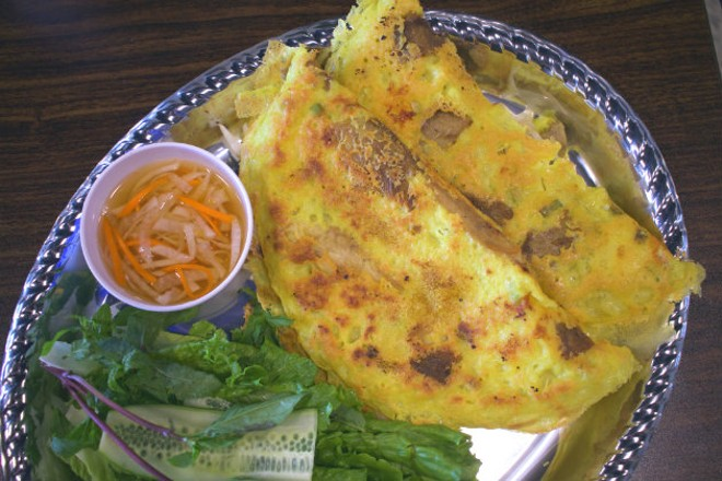 A Vietnamese-style crepe with bean sprouts, pork and chicken. - CHERYL BAEHR