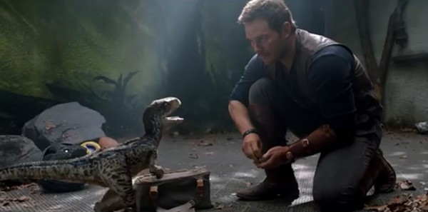 Owen (Chris Pratt) tries to explain who Greg Evigan is to one of the younger readers. - (C) UNIVERSAL PICTURES 2018