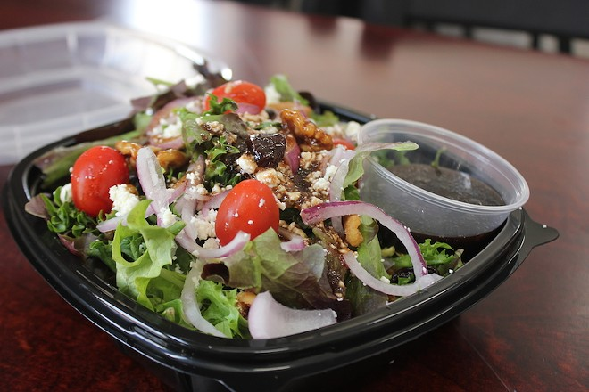 """The Cherry Bomb"" salad is topped with an addictively tart cherry balsamic dressing. (Shown is a half-size portion.) - SARAH FENSKE"
