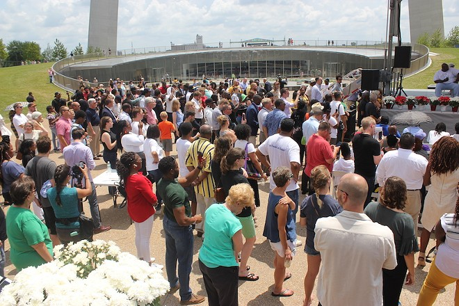A large crowd gathered at the Arch's base. - ALISON GOLD