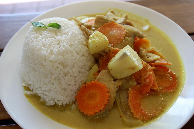 The yellow curry comes with choice of protein, carrots, potatoes and onions with a side of rice. - LEXIE MILLER