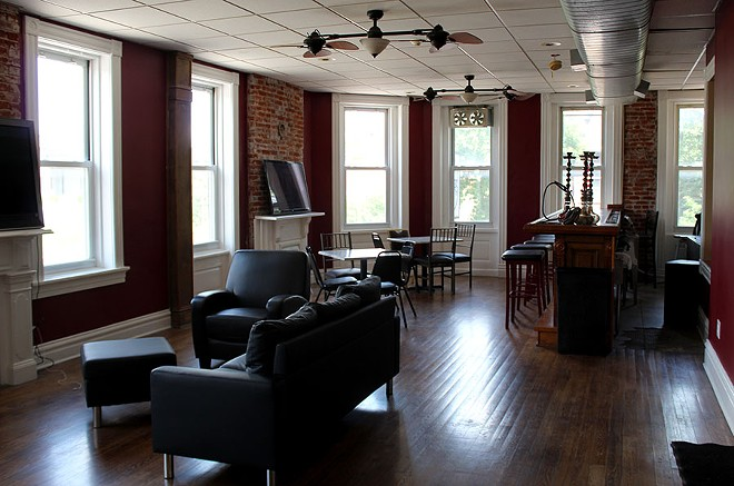 The clubhouse has its own bar, TVs and wifi so customers can relax and do work in this quiet upstairs. - LEXIE MILLER