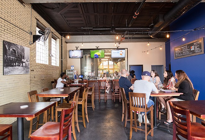 Beyond large doors that open garage-style is a tap room perfect for summer drinking. - MABEL SUEN