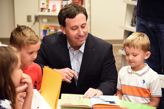 Steve Stenger reads with young students as part of the library's Recycled Reads event. - KARA SMITH/ST. LOUIS COUNTY LIBRARY