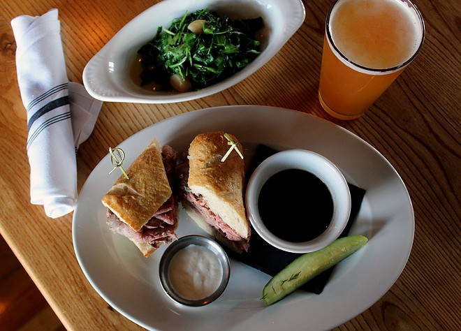 The French Dip sandwich served with Horseradish cream and a side of sauteed greens. - LEXIE MILLER