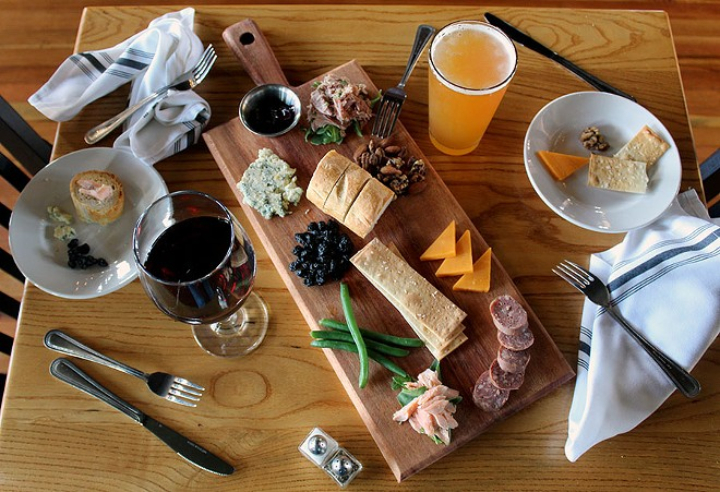 The Hunter's Board with venison sausage, duck rillettes, smoked trout, cranberries, sharp cheddar, bleu cheese, nuts, pickled veggies, raspberry geranium jam, flatbread and bread. - LEXIE MILLER